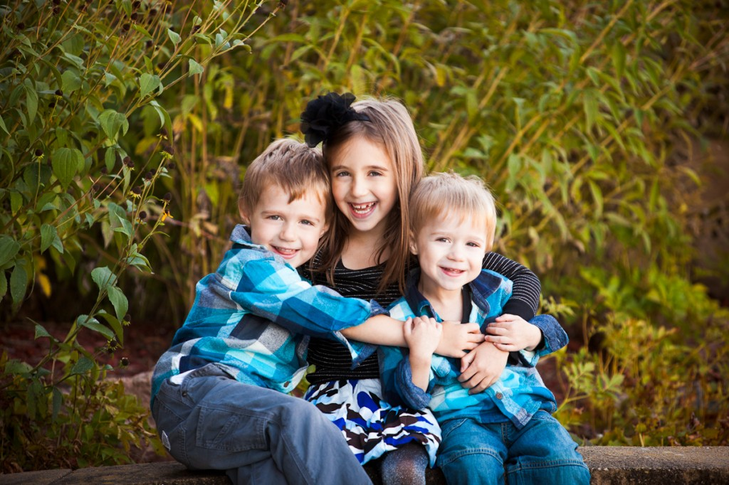 three siblings hugging during family portraits