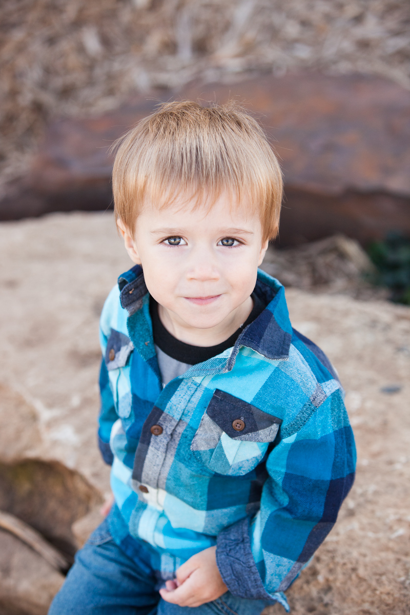 Boy smiling at camera in blue plaid shirt